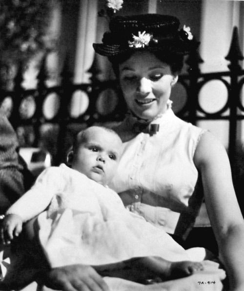Julie Andrews with her baby, Emma, on the set of Mary Poppins.