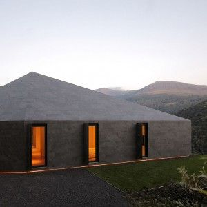 Faceted+home+in+the+Swiss+Alps+by+JM+Architecture+is+covered+in+dark+grey+tiles