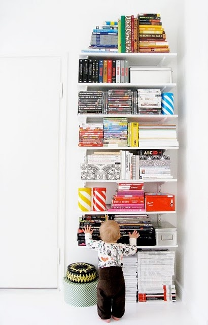 love this colour coded bookshelf!