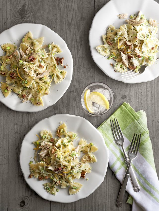 Toasted pecans add unexpected warmth and crunch to this creamy pasta dish. Recipe: Creamy Chicken-and-Broccoli Pesto Bow Ties   - CountryLiving.com