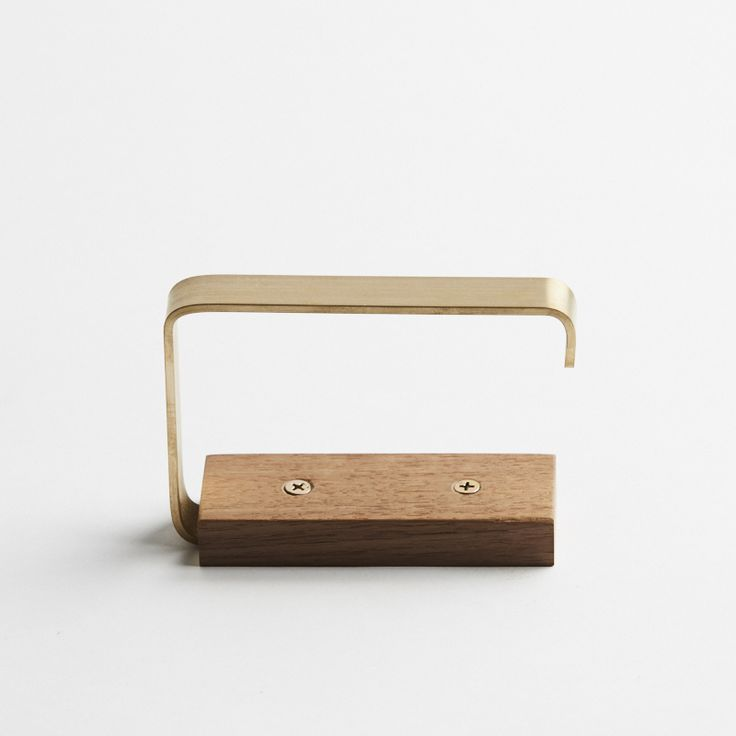 Gilbert Brass and Timber Toilet Roll Holder. Victorian Ash hardwood, in a hand-waxed finish, with raw brass. Wide fit for large toilet rolls. Solid timber with visible end grain. Fixed to your wall with brass screws.