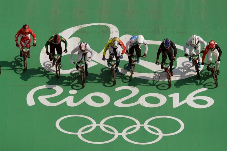 Cyclists, from right, David Graf of Switzerland, Luis Brethauer of Germany, Liam Phillips of Britain, Tory Nyhaug of Canada, Jefferson Milano of Venezuela, Maris Strombergs of Latvia, Kyle Dodd of South Africa and Toni Syarifudin of Indonesia compete in the BMX cycling quarterfinals during the 2016 Summer Olympics in Rio de Janeiro, Brazil, Thursday, Aug. 18, 2016. (AP Photo/John Locher)