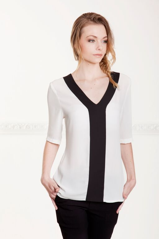 Mansuria Blouse available @ Hermanna Rush  This Simple contrast panel blouse is perfect for an evening out or just a day at work  R690  To order email melissa@hermannarush.com