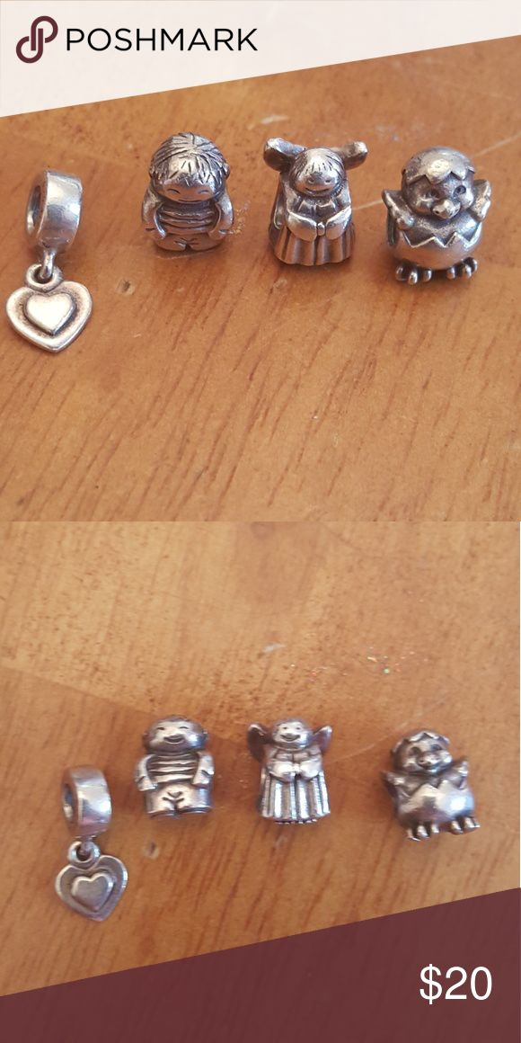 Pandora Charms Selling four pandora charms... a baby chick, angel, little boy, and dangling heart.. Selling all four for $20 Pandora Jewelry Bracelets