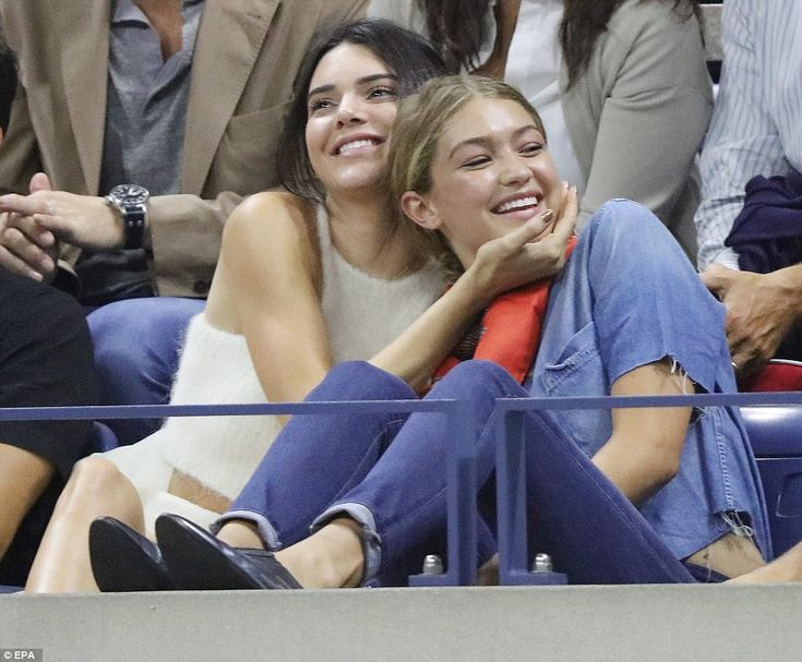 Kendall Jenner  and  Gigi Hadid watch as Venus Williams of the US plays Serena Williams during their quarterfinals match
