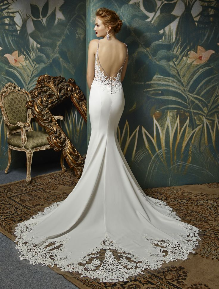 Enzoani bridalwear. Juri back. Juri design from the Enzoani Blue 2017 collection.  Sweetheart sheer lace bodice with thin straps. Figure hugging  mermaid wedding dress with long lace train.