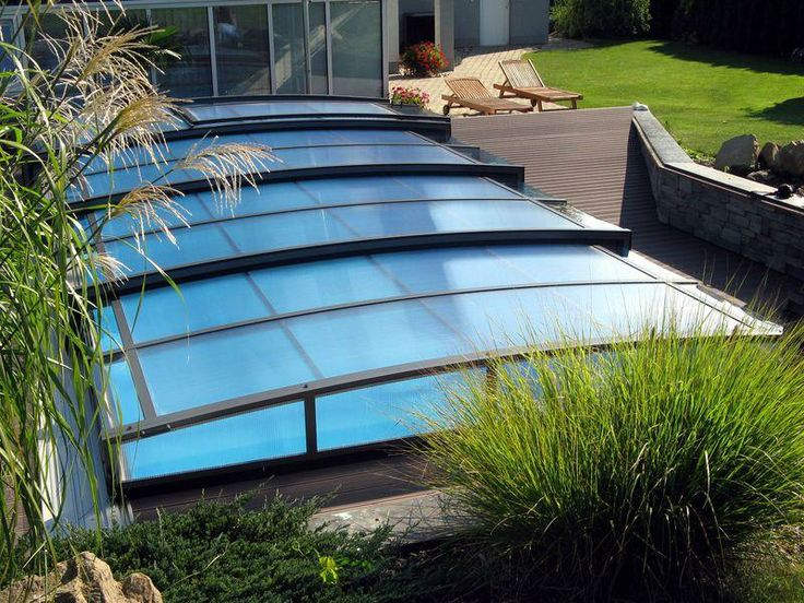 Retractable swimming pool cover corona protects your pool for Retractable pool enclosures cost
