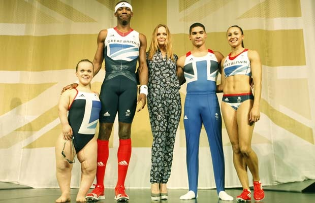 Left to right: Eleaonor Simmonds, triple jumper Phillips Idowu, gymnast Louis Smith and heptathlete Jessica Ennis pose wearing the new Team GB kits designed by British designer Stella McCartney (centre) for the London 2012 Olympic Games, at a viewing in London on Thursday, March 22, 2012.