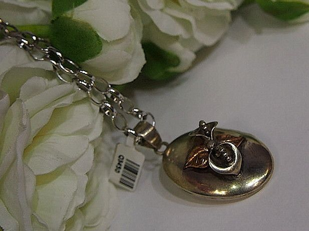 Jewellery-Pendant-Vintage-Victorian three Dimensional Oval Opening Locket featuring Calla Lillies in silver and rose gold.