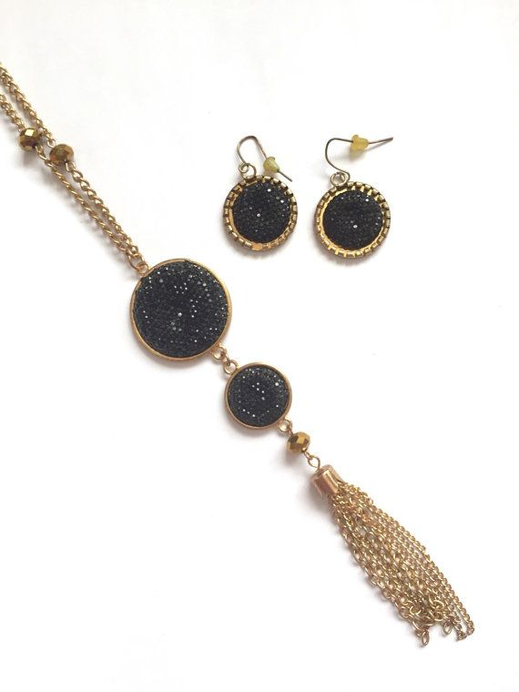 Beautiful and stylish long necklace and earrings from the 1980s. Black faux crystal pendants with chain tassel. Mirror-shine goldtone beads