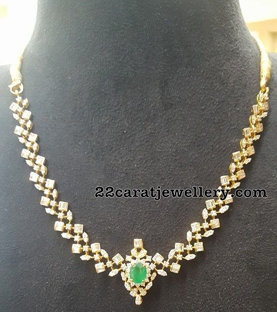 18 carat yellow gold metal intricate very elegant yet simple look diamond necklace with Large emerald adorned simple pendant merged in th...