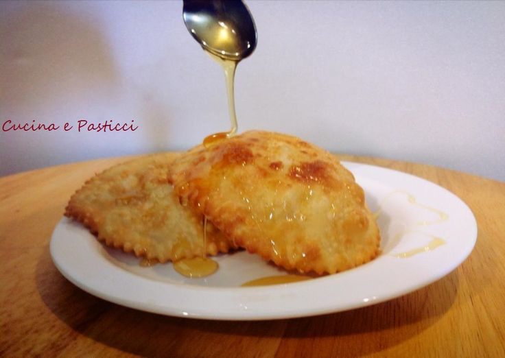 Sebadas - traditional fried Sardinian semolina pastry, filled with cheese, drizzled with honey.