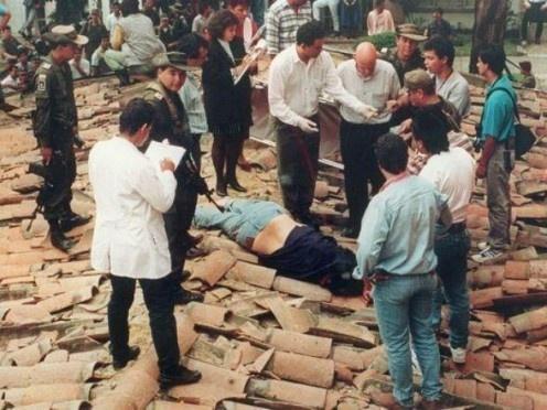 Pablo Escobar dead on a rooftop in Medellin