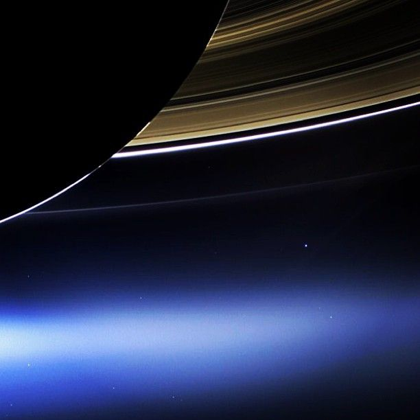 Pale Blue Dot 2.0 - taken from Saturn 898 million miles away, Earth and all its trillions of creatures are seen as a speck of light in the vastness of space. That's here. That's home. That's us.
