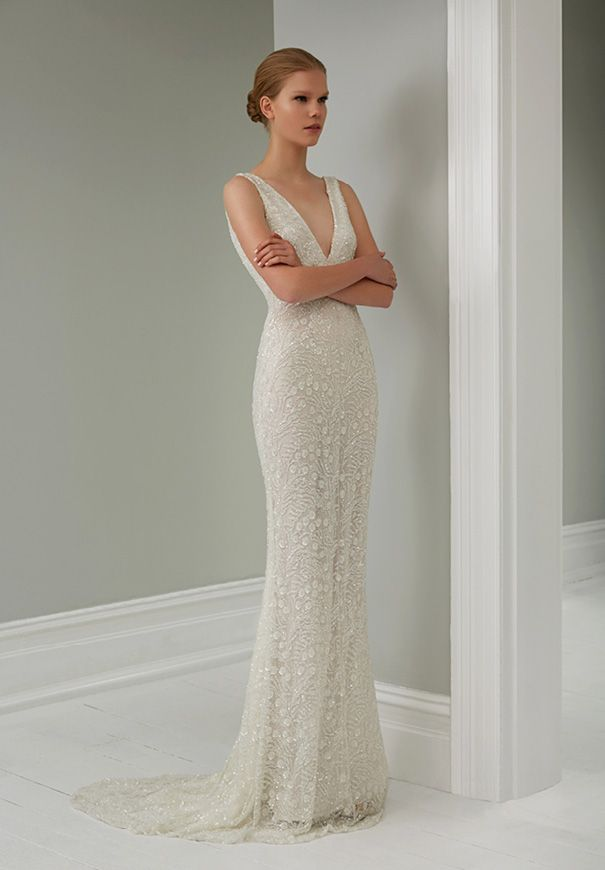 Jaime Y Beaded Column Sheath Wedding Gown Showcasing A Deep Plunging V Neckline Open Back Along With Sweep Train Front Full View By Steven
