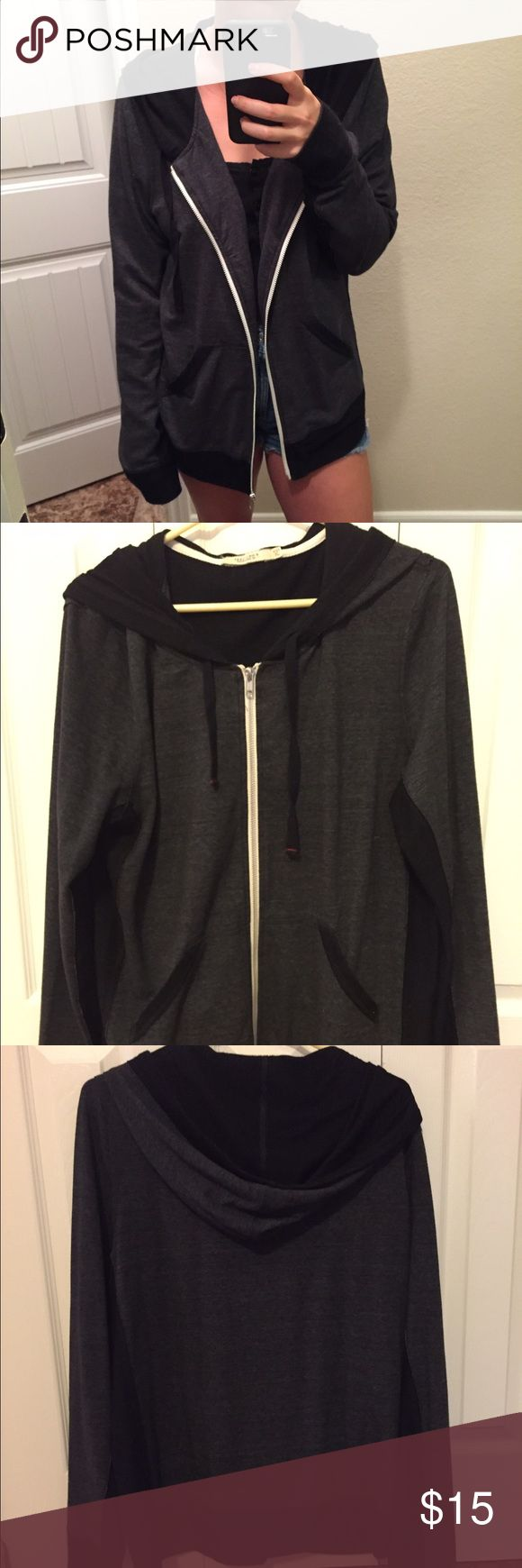 Black and gray zip up hoodie Super comfy black and grey zip up hoodie in size XL! Only worn a few times and in really good condition. I think I actually bought this at Costco 😊😊 H&M Jackets & Coats