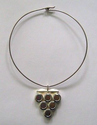 Nanny Still for Kultakeskus Oy, Sterling silver necklace with titanium stones, 1976.