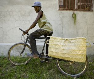 We just made a longtail cargo bicycle from a second-hand Ukrainian mountain bike. It was made in Haiti with a minimum amount of tools and measuring, b...