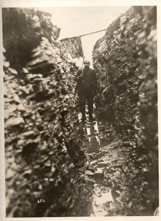 Photo: dark, cold, wet, trench, soldier. Bad. WWI. 1918.