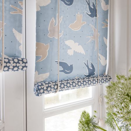 Roller blinds with contrasting pattern on the reverse. Maritime collection shown.