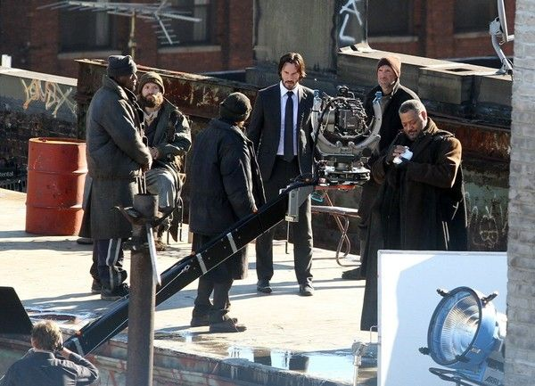 Keanu Reeves Photos Photos - Actors Keanu Reeves and Laurence Fishburne are spotted filming scenes for 'John Wick 2' on a rooftop in New York City, New York on December 15, 2015. - Keanu Reeves and Laurence Fishburne Film 'John Wick 2' in NYC