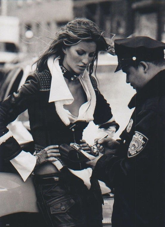 he's giving gisele a ticket?