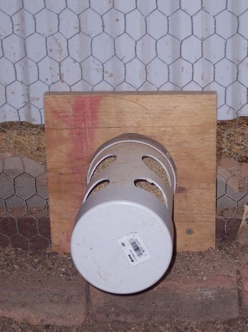 Chicken coop (feeder) connect to down pipe to make hopper.