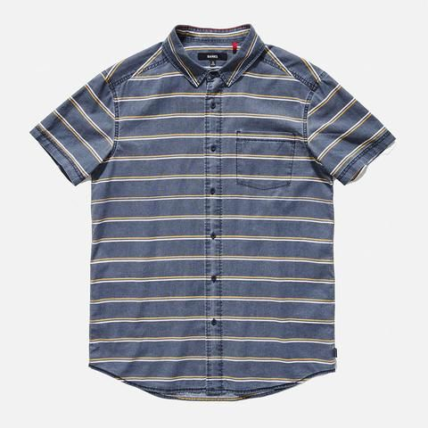 Slim fit, 100% cotton, Custom buttons, Inner red stitch detail, Chain stitch hem, Back yoke, Front pocket, Recycled polyester woven labels.