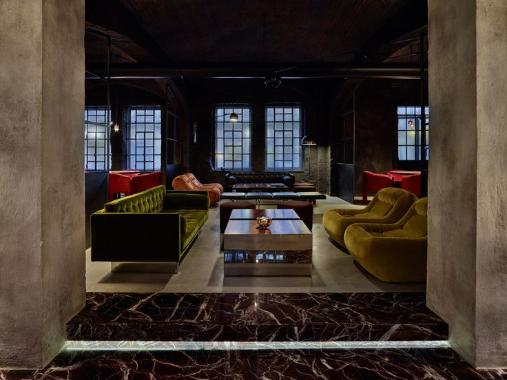 Turin a cavernous industrial structure brews into a restaurant with a dazzling 70s details in