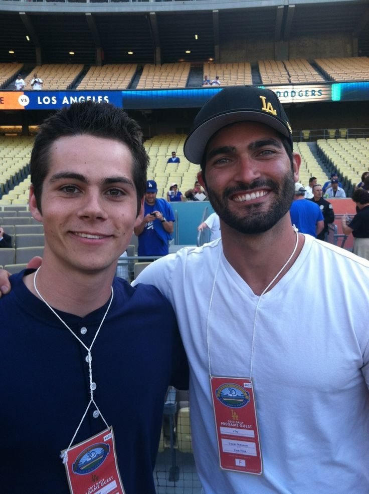Tyler Hoechlin is throwing out the first pitch at Dodger's game and Dylan O'Brien is catching it!Both are from Teen Wolf on MTV.