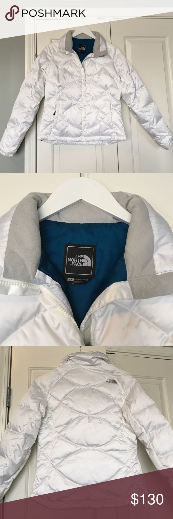 North Face winter coat White North Face coat with blue interior. The pockets are lined with the gray material seen on the collar and are very warm! North Face Jackets & Coats