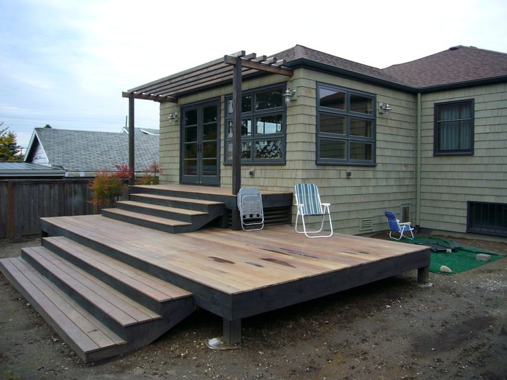 gray kat residential design studio - 40s bungalow face lift - Ironwood deck and arbor - hip roof - cedar shingles