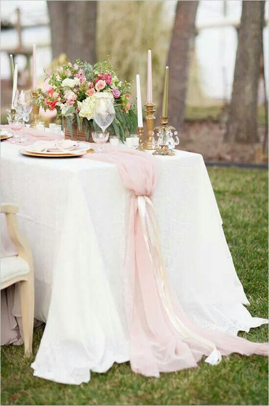 This simple pink chiffon table runner tied with satin ribbon streamers really makes this reception table.