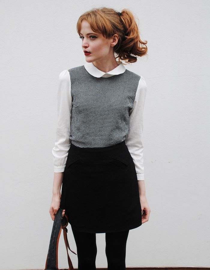 Blouse with cream Peter Pan collar and sleeves with black and white bodice, black skirt and black tights
