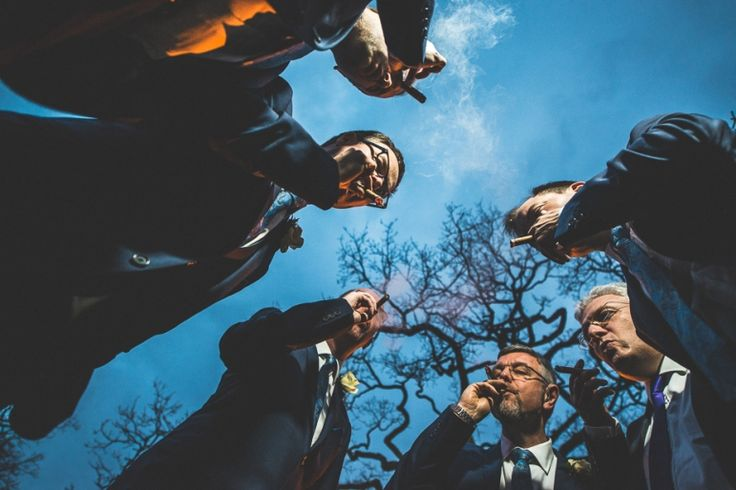 Groom and Groomsmen smoking cigars at their Warren House wedding