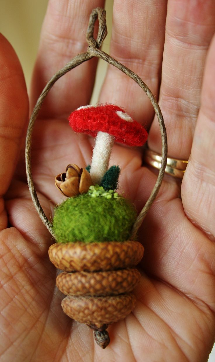 Stacked acorns and felted mushroom