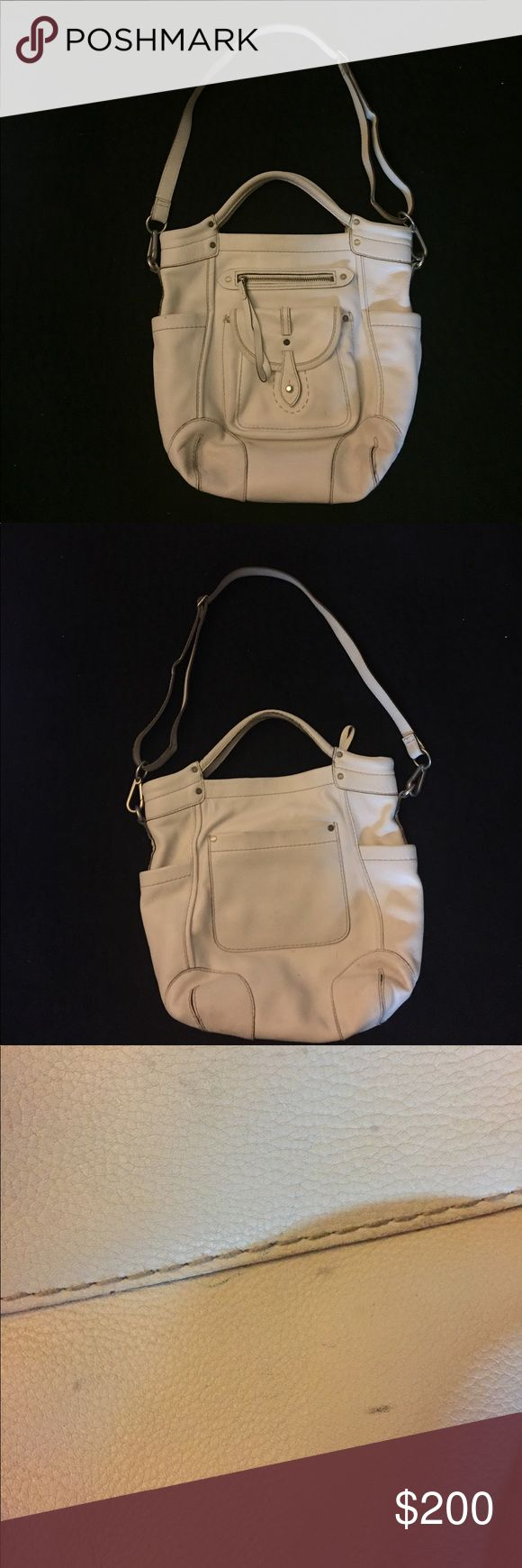 "Abercrombie and Fitch Ruehl Handbag Off white leather Abercrombie and Fitch Ruehl Handbag. I absolutely hate to give this bag up but I do not use it due to having way too may handbags. There are a few marks on the back of the bag that are shown. However they cannot be seen while wearing. My loss is your gain. This bag has thick heavy leather that will last a long long time. White is in ladies so snatch it up before someone else does. Adjustable removable strap.  Strap drop: 20.5"" Ruehl No…"