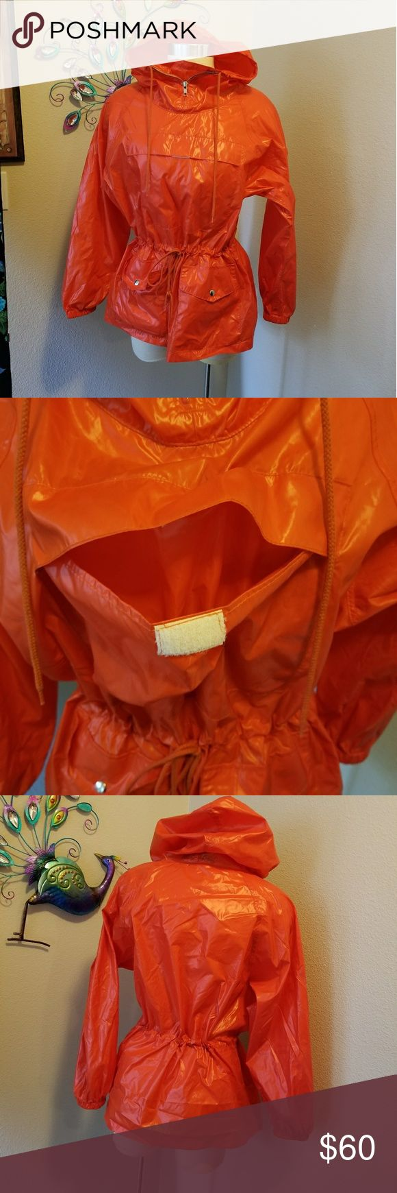 Vintage Ralph Lauren nylon rain parka 1960's Awesome vintage authentic 1960's Ralph Lauren orange rain parka. 100% nylon excellent condition, drawstring for sizing. Could fort small to medium. Chest Velcro pocket, maybe for beach rock hunting? Very cool. Rare find. Vintage Jackets & Coats Utility Jackets