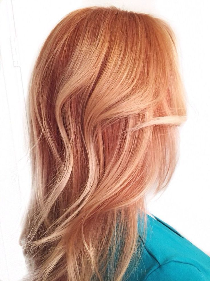 Pink-toned strawberry rose gold hair