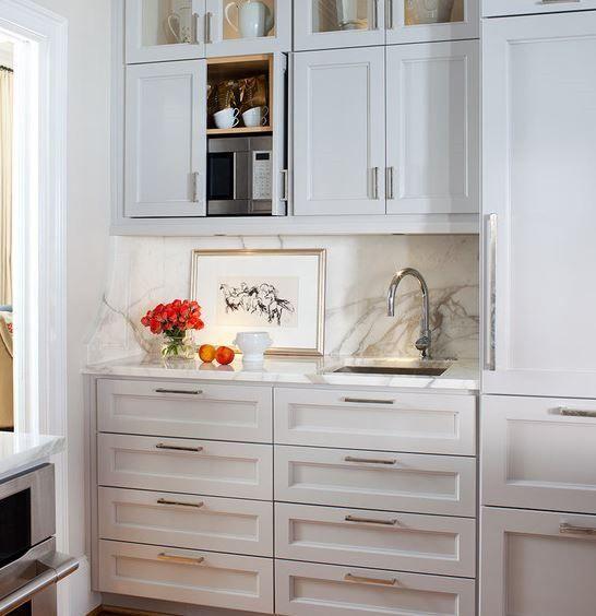 Kitchen: hidden microwave in upper cabinet