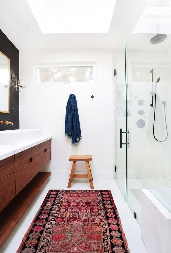 Skylight in a master bathroom with a pattered rug