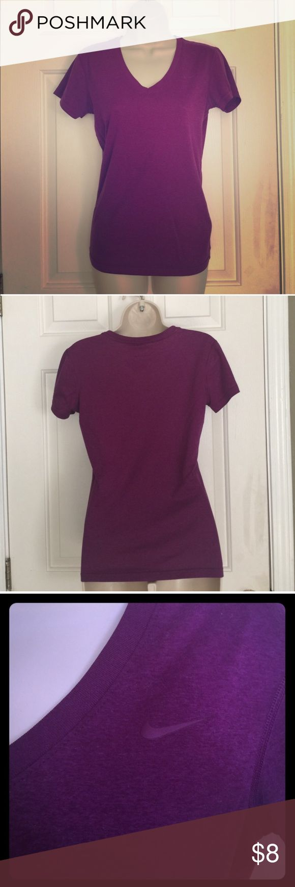 Purple Short Sleeve Nike Dri Fit (worn once) EUC ! No flaws ! Realized I only like to workout in tanks lol-beautiful purple (sort of like a light maroon) color. Last 2 pics show the color exactly as is I don't know why the first pic automatically put a filter on it. Nike Tops Tees - Short Sleeve