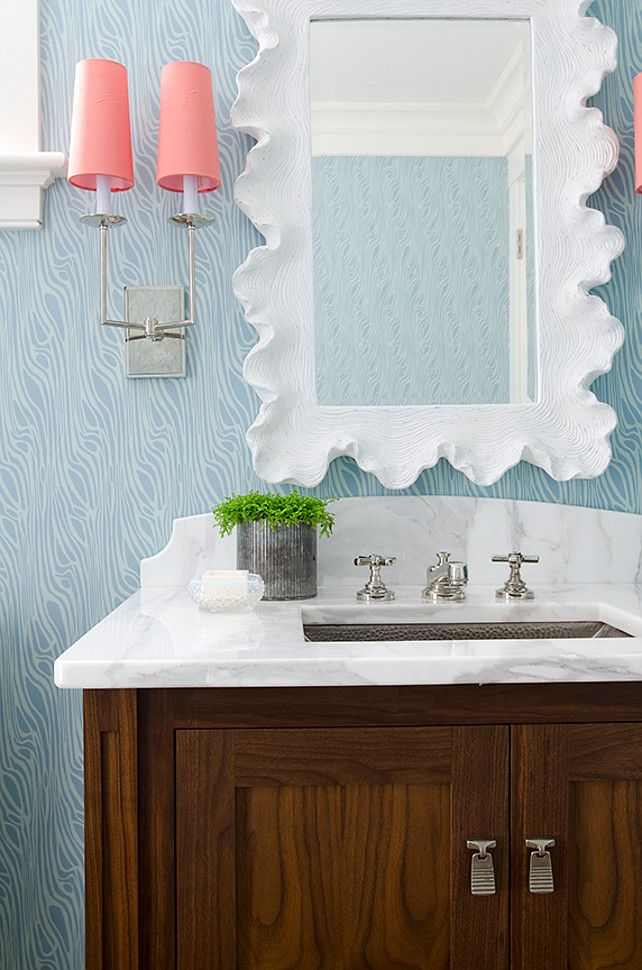 Blue Turquioise Wallpaper. Powder room with blue turquoise wallpaper, white mirror and coral sconces. #Turquoise #Wallpaper #PowderRoom Kristina Crestin Design.