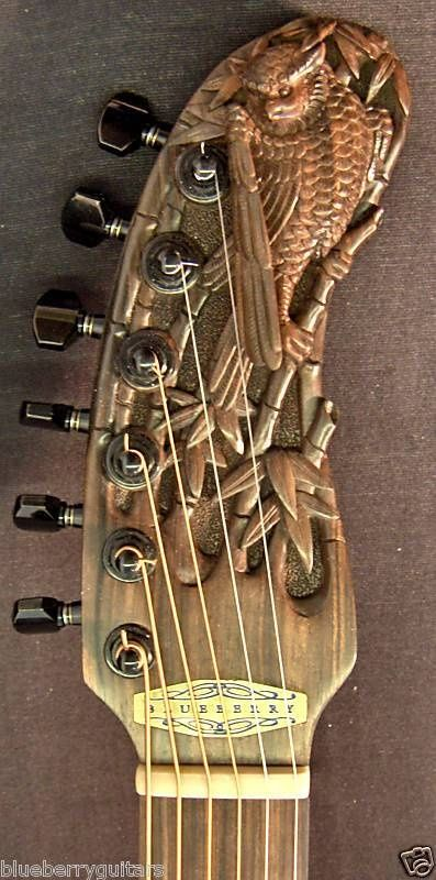 Beautifully Carved wooden guitar headstock.  -cSw:) - http://www.pinterest.com/claxtonw - Pin via #DdO:) MOST POPULAR RE-PINS  http://www.pinterest.com/DianaDeeOsborne/instruments-for-joy - INSTRUMENTS FOR JOY. A touch of Roman Imperial History look in this BLUEBERRY model brass gold colored CURVED headstock. Unusual shape electric guitar headstock, that features a hawk, falcon or similar bird with fascinating unique detail. Dark tuning pegs add to rich luxury look. Photo source Premier…
