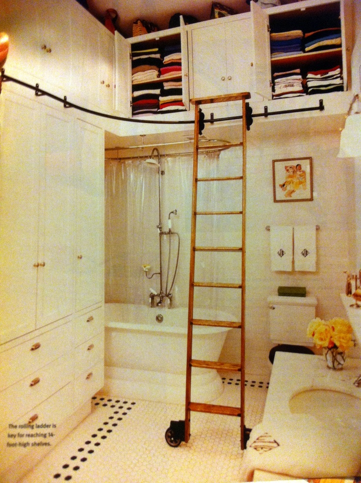 library ladder/storage & claw-foot tub bathroom -this is genius!