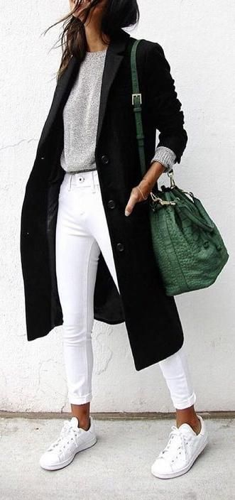 white skinny. grey tee. black coat. green bag.