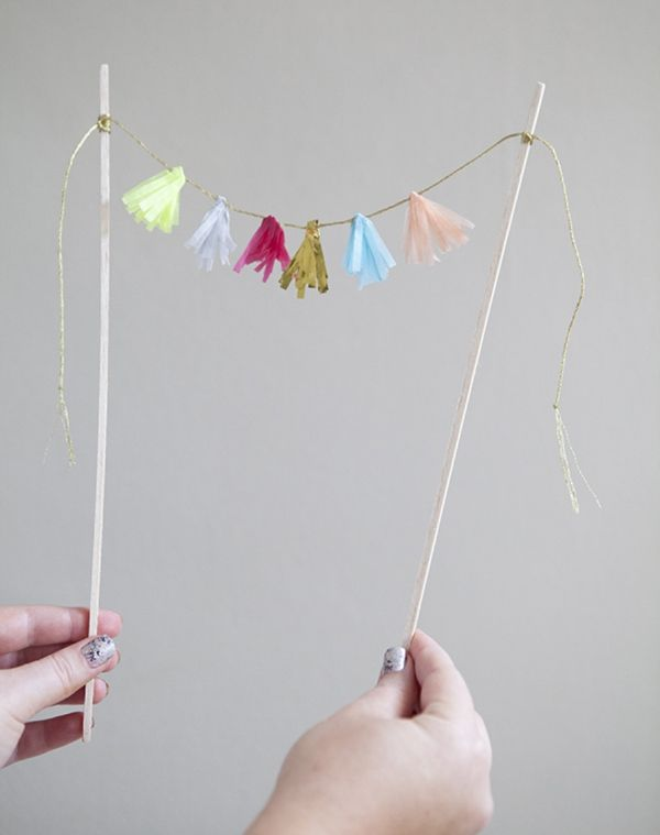 DIY How to make a tissue tassel garland cake topper!