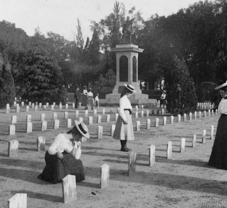 "Ladies visit the graves of Confederate soldiers in Charleston, SC. See photos of ""the fallen of the mighty Conflict"" in an American Experience slideshow (warning: graphic content)"