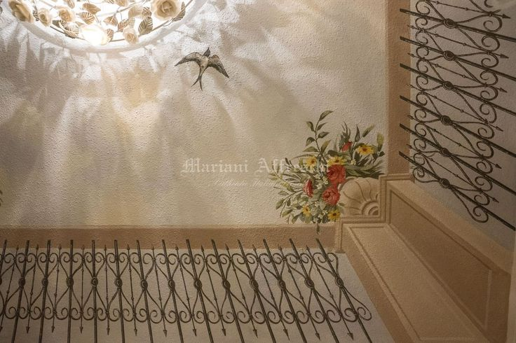 Detail of the trompe l'oeil painting on the ceiling, simulating the view of the sky beyond a wrought iron balustrade