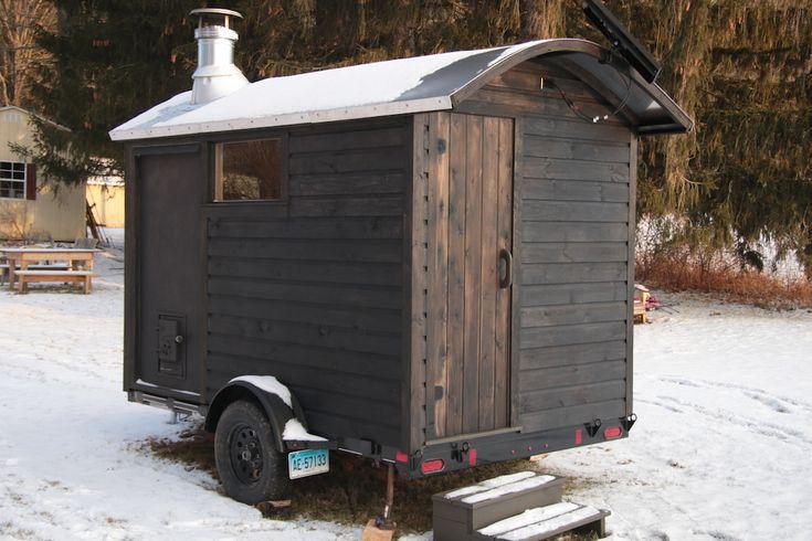 wood burning mobile sauna with pine tar finish by Rob Licht Custom Saunas